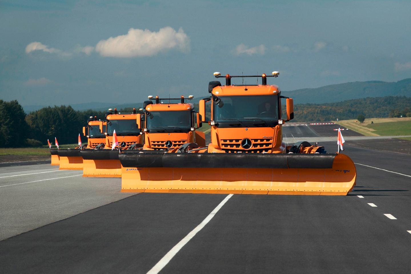 "Under the project name ""Automated Airfield Ground Maintenance,"" four Mercedes-Benz Arocs tractors demonstrate automated airfield clearing as a convoy"