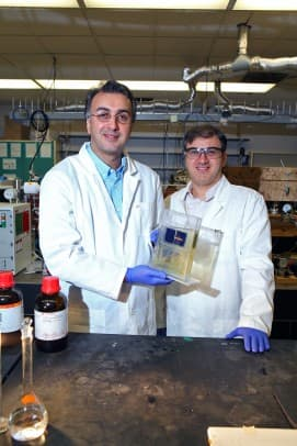 Amin Salehi-Khojin (left), UIC assistant professor of mechanical and industrial engineering, and postdoctoral researcher Mohammad Asadi with their breakthrough solar cell