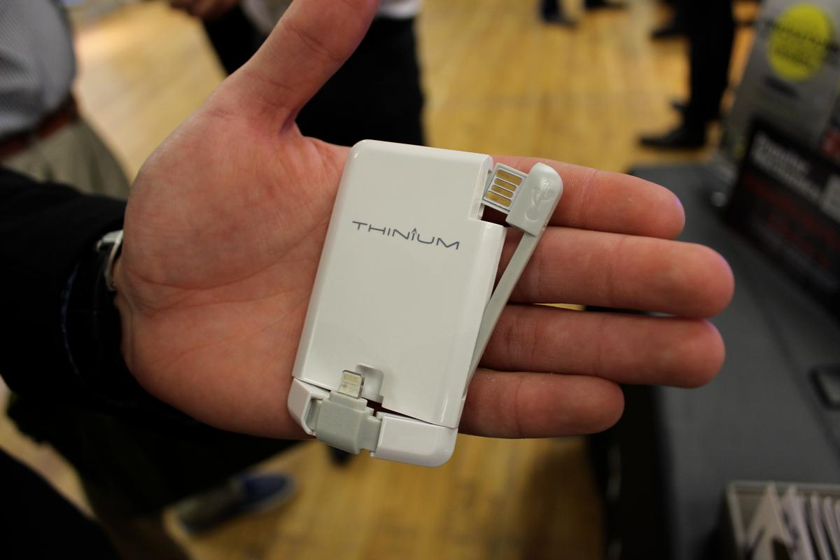 The Thinium Charge with its Lightning plug and USB dongle extended