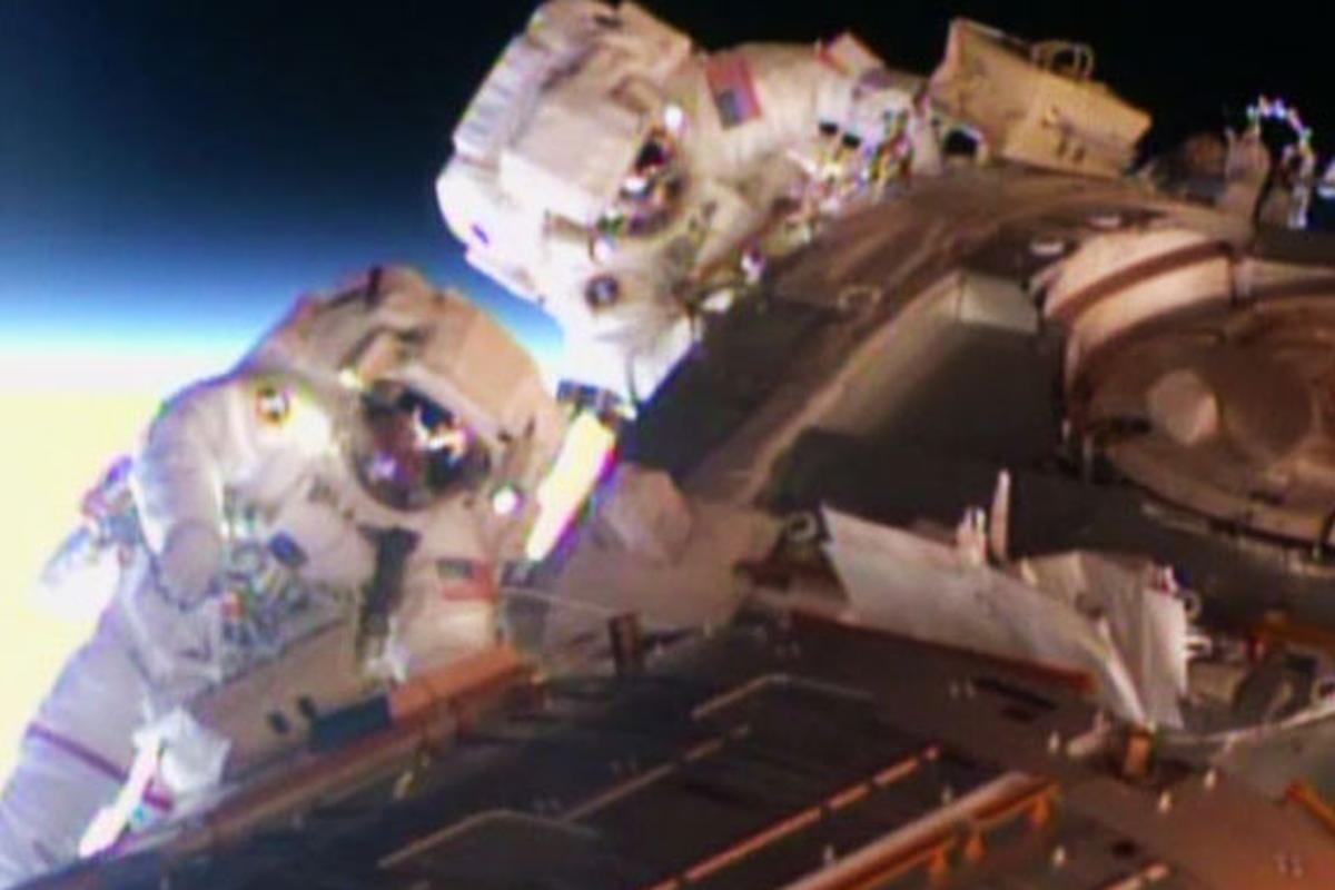 Astronauts Terry Virts and Barry Wilmore working on the exterior of ISS's Harmony module (Photo: NASA TV)
