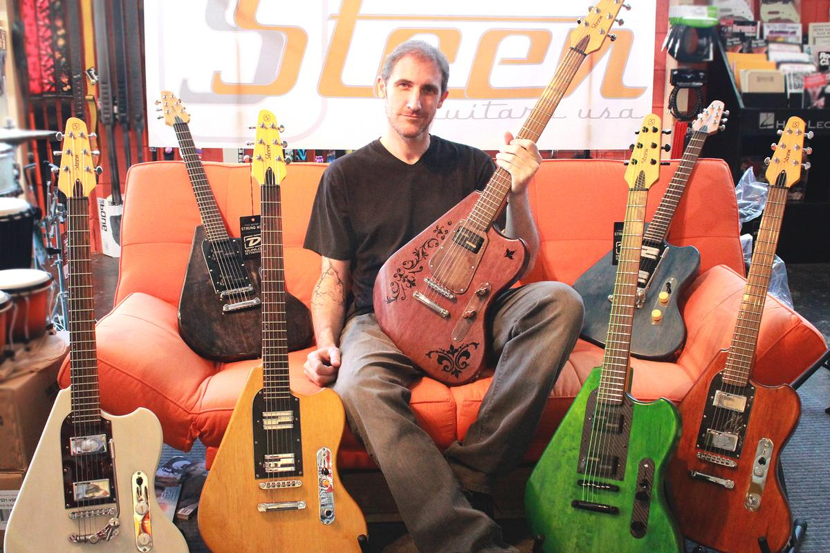Shawn Steen with his ergonomically-designed guitars