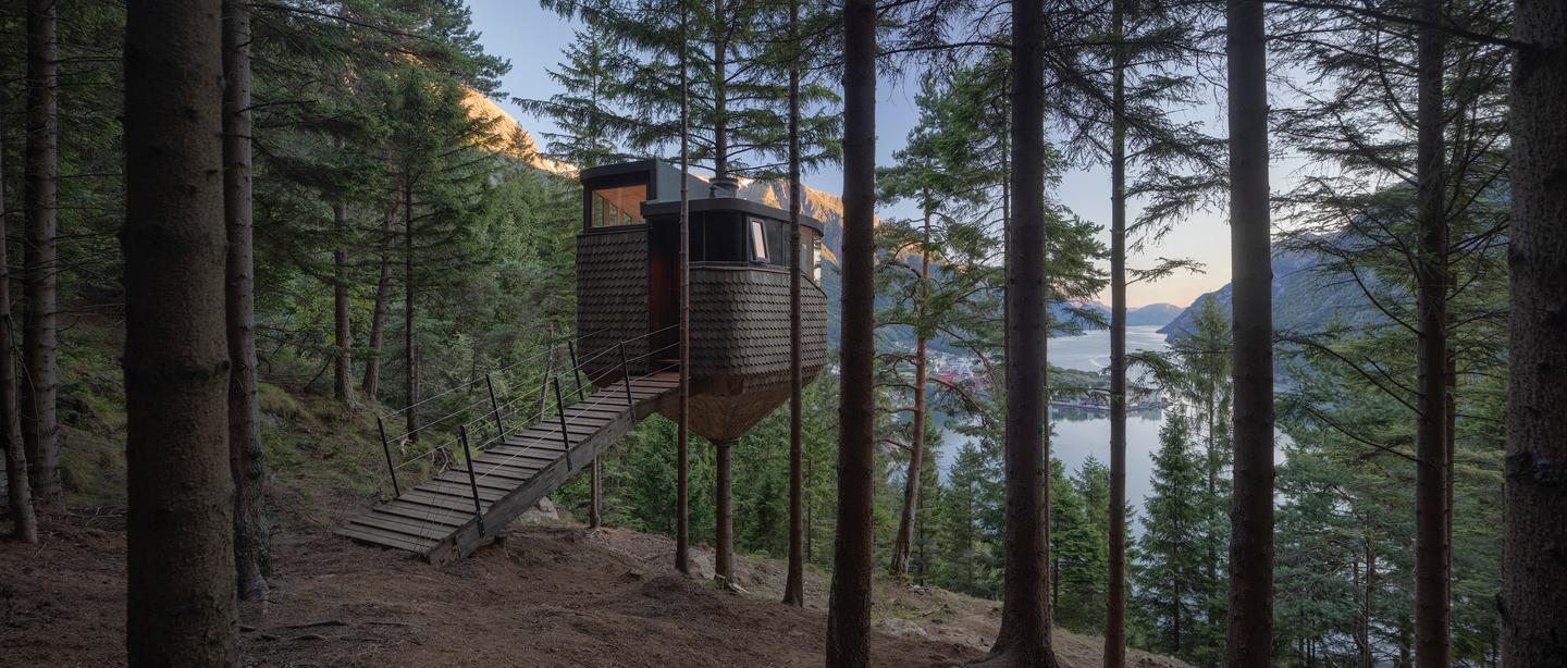 """""""The journey to the site begins with the 20 minute walk from the town of Odda, on the edge of the fjord and up through the forest via a steep winding path,"""" says Helen & Hard"""