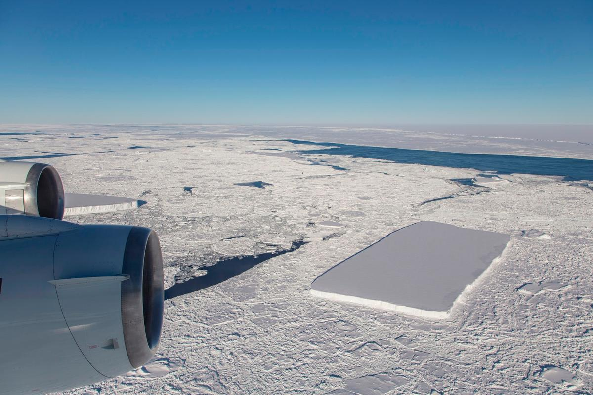 Just past the rectangular iceberg, which is visible from behind the outboard engine, IceBridge saw another relatively rectangular berg and the A68 iceberg in the distance