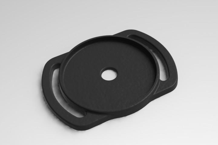 Each lens cap holder is designed to hold three or four different-sized lens caps (two on one side and one or two on the other), although (obviously) only one cap can be secured in the holder at any one time
