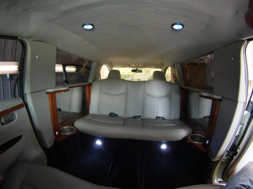 The interior of the Leaf limo features leather upholstery and cedar paneling (Photo: Imperial LimoLand)