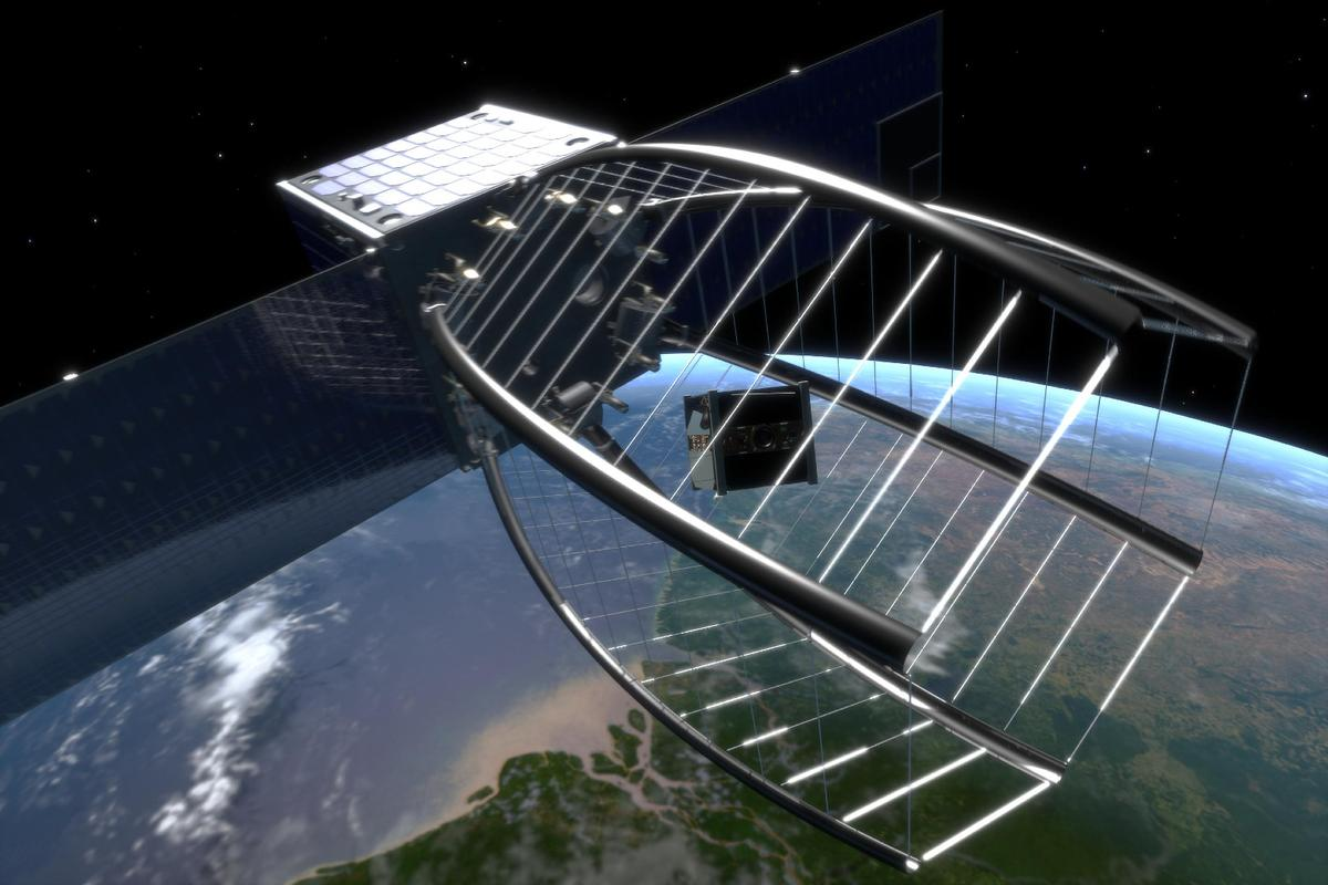 CleanSpace One uses its net to envelope the SwissCube satellite