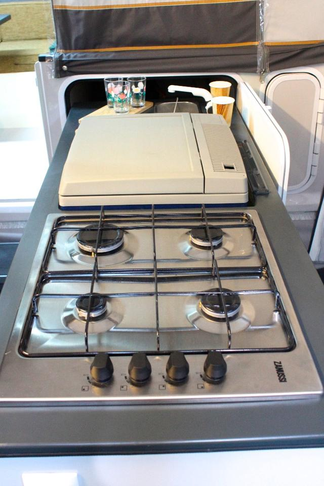 The iCamp packs some extra cooking power with its four-burner stove (two-burners are more standard on small campers)