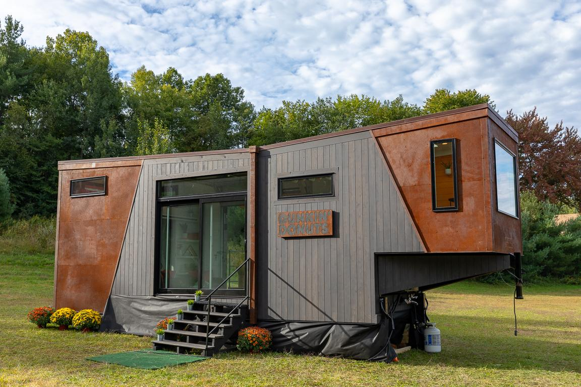 The Home That Runs on Dunkin' appears to be based on New Frontier Tiny Homes' Escher model
