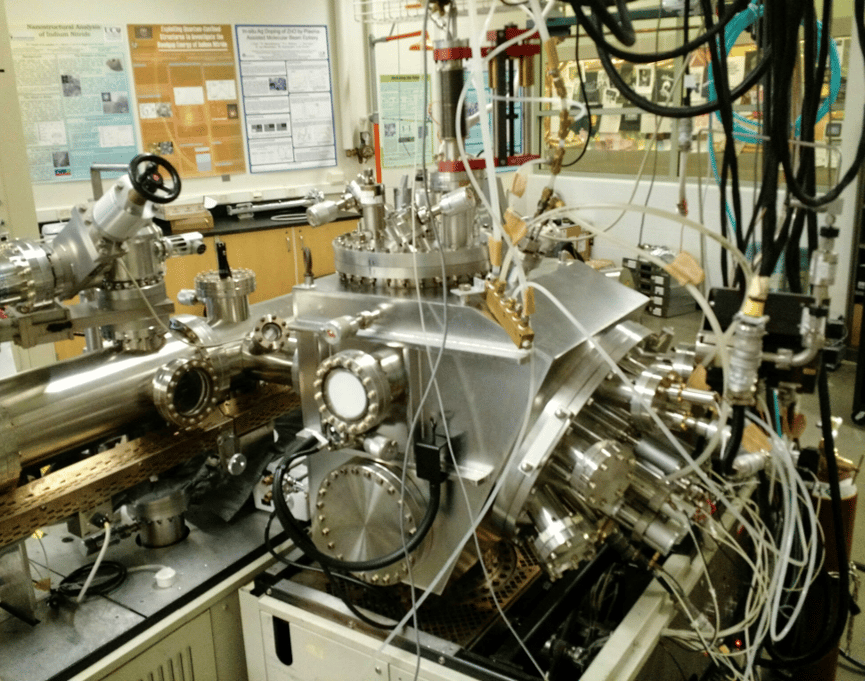 A molecular-beam epitaxy system lays down each atomic layer of the compound in a systematic fashion, so researchers can study the thin layer, or film, structure as they grow it