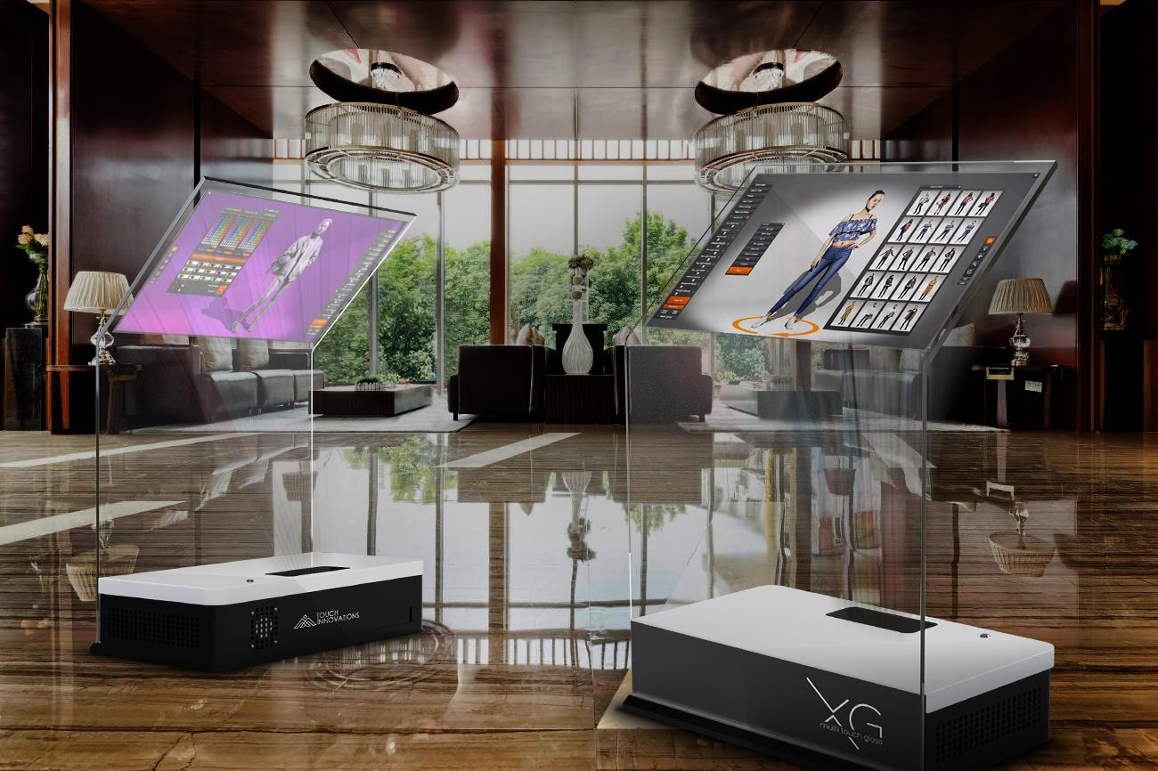 Touch Innovations imagines its new XG see-through touch controller will find use in high-class showrooms
