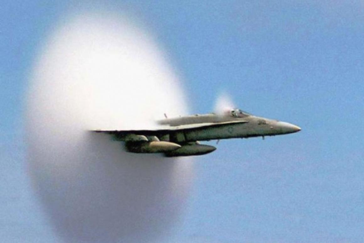 An F/A-18E/F Super Hornet breaks the sound barrier