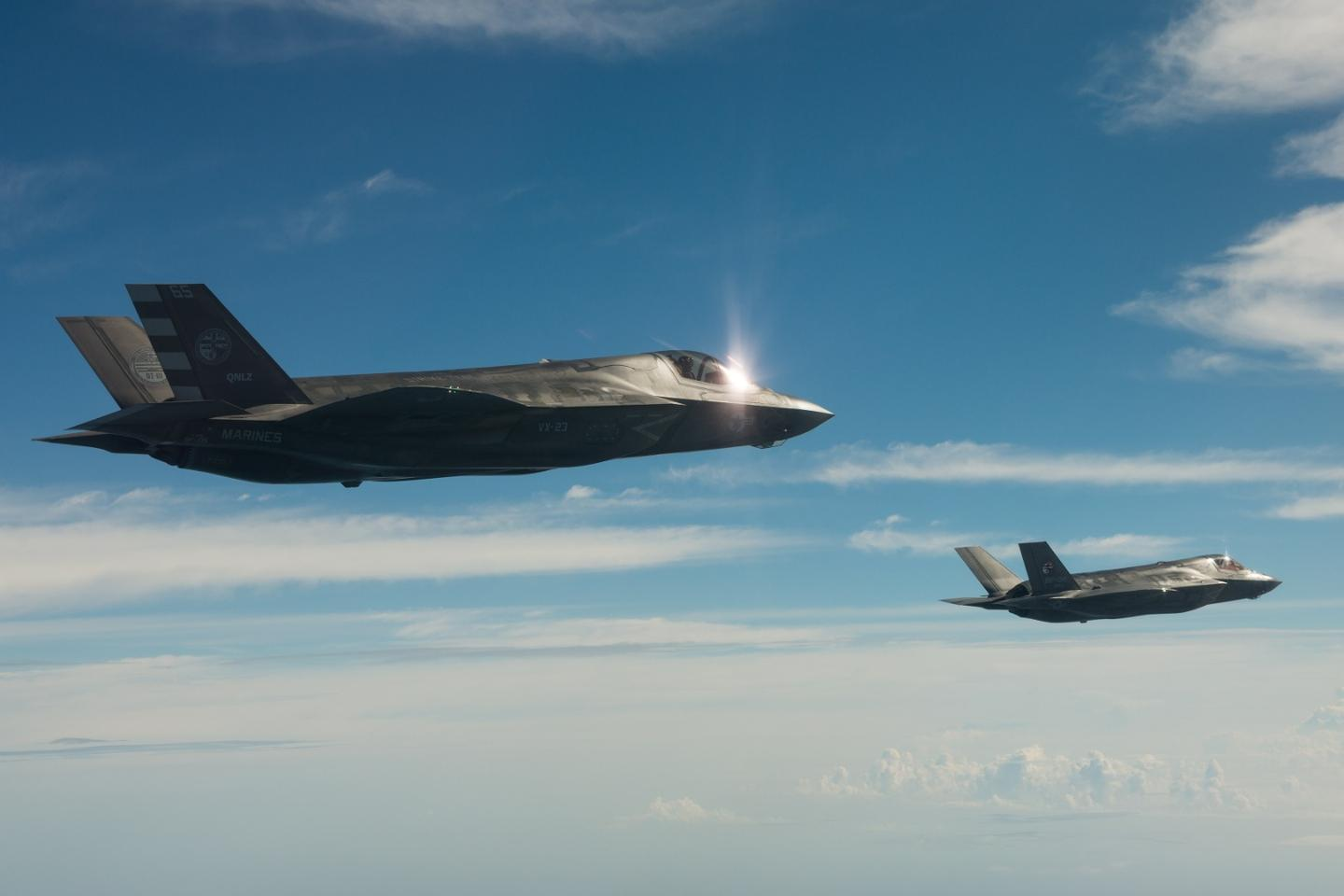 Two F-35 fighters in flight