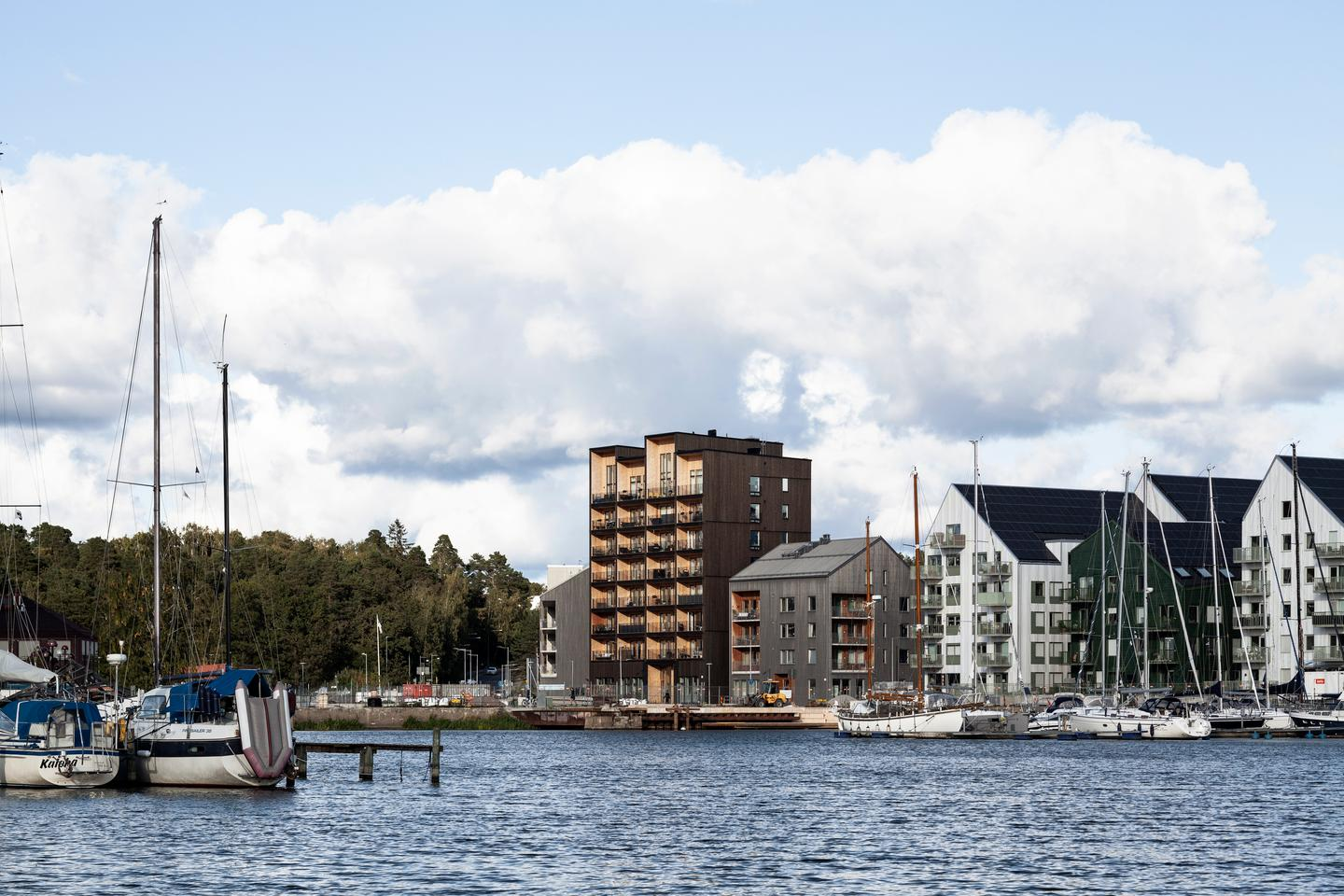 The Kajstaden Tall Timber Building is located next to a lake in Västerås, Sweden
