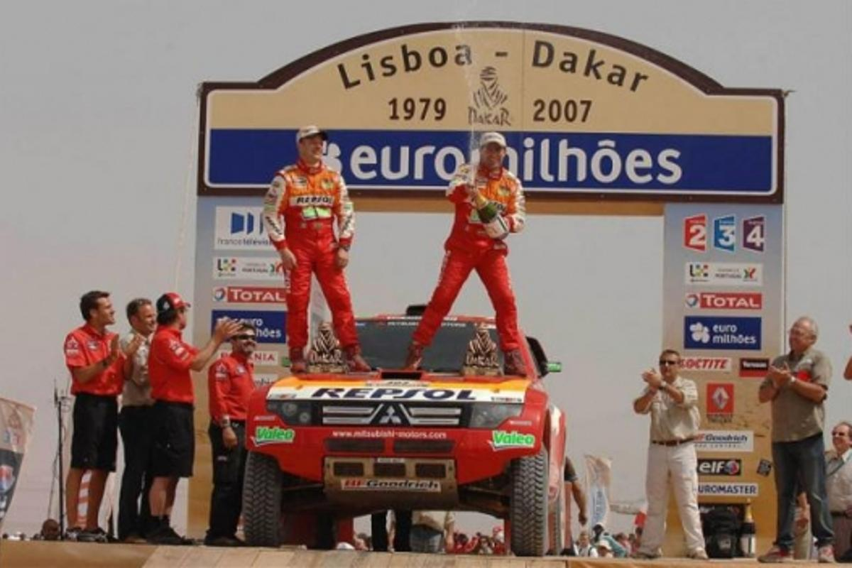 Stephane Peterhansel and Jean-Paul Cottret celebrate their victory in the 2007 Dakar Rally.