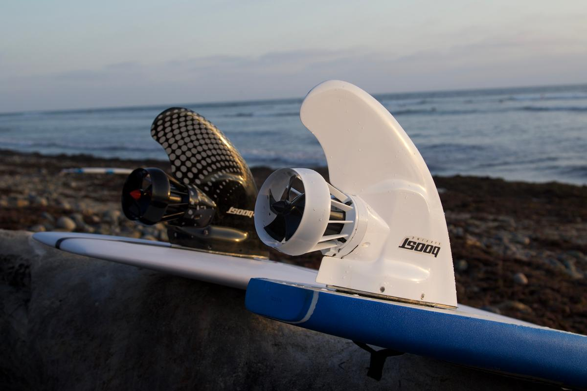 The Boost Surfing Fin temporarily replaces a third-party board's existing fin, via an included adapter