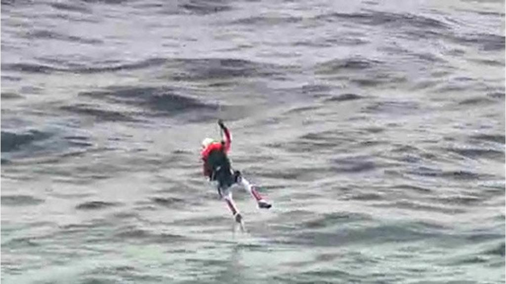 Fusionman, Yves Rosy, is winched to safety after his failed intercontinental crossing