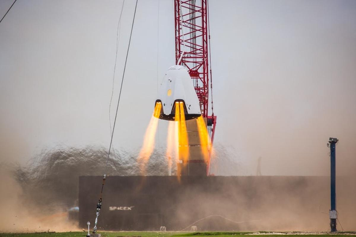 A Crew Dragon undergoing a hover test in 2016