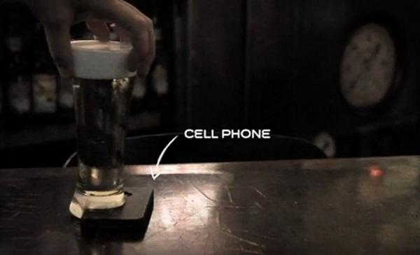 The concept of the Offline Glass explained in visual form, with a smartphone wedged under the beer to keep it upright