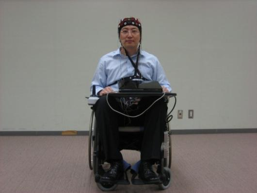 The Toyota/RIKEN wheelchair is fitted with an EEG detector in the form of a electrode array skull cap (Photo: RIKEN)