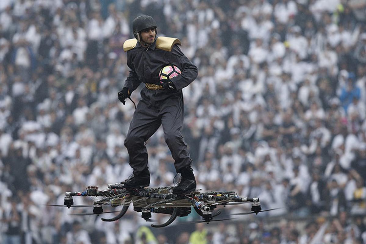 Alexandru Duru, CEO of Omni Hoverboards, running a demonstration flight at a soccer game