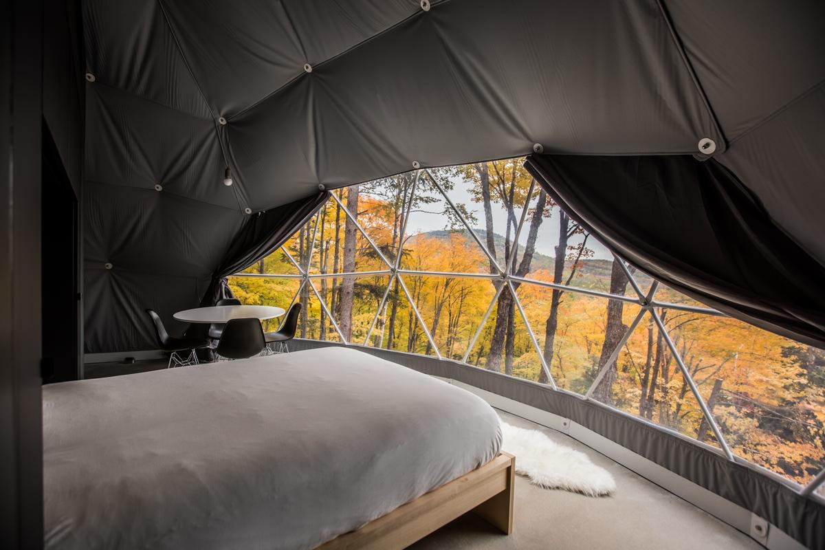 The drapes can also be drawn back to reveal the breathtaking views across the valley, with exclusive views of the Saint-Laurent river