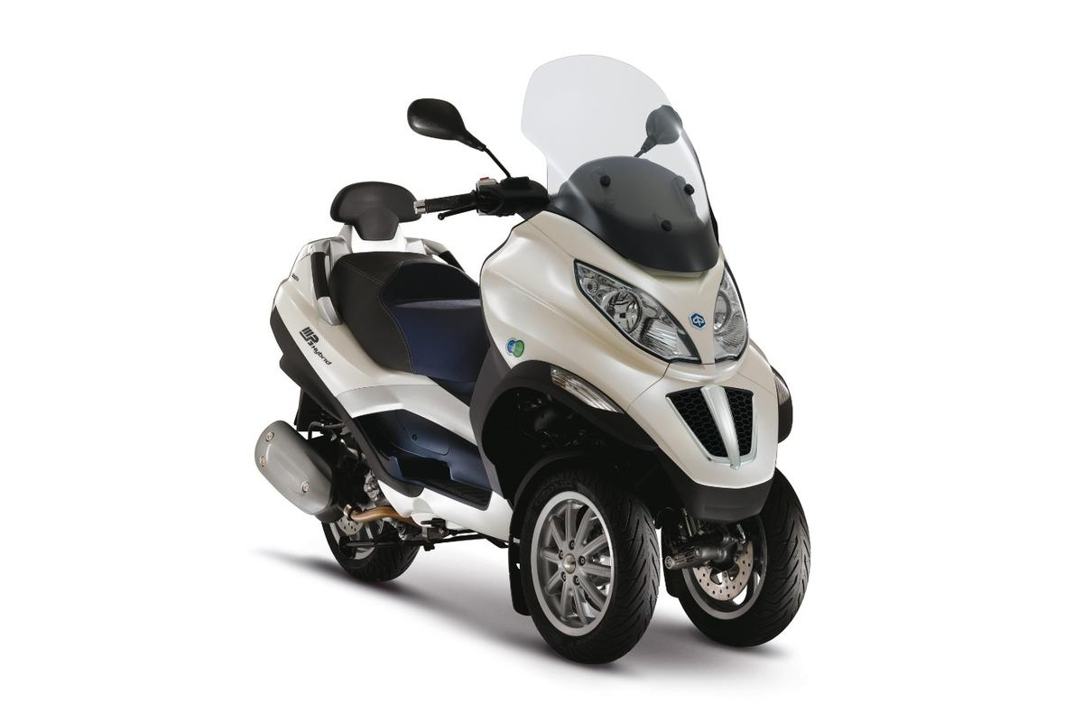 Piaggio's MP3 Hybrid 300 i.e. LT has been available since 2009, with a combination of a 278 cc internal combustion engine and an electric motor