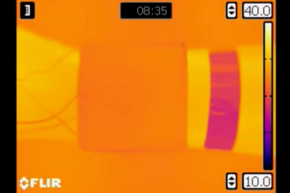 An armband made of the material (imaged in orange) changes temperature to match its environment