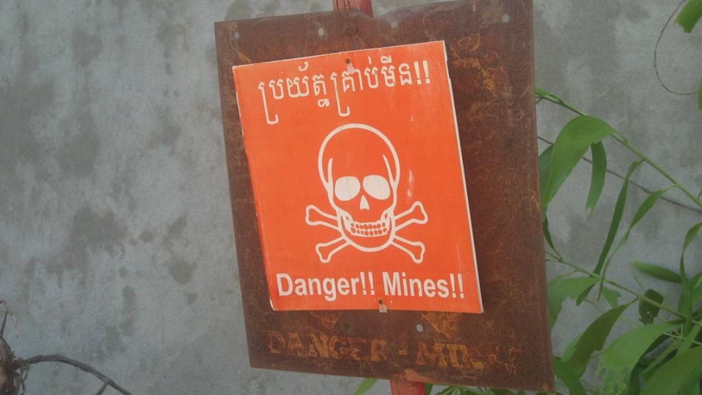 A land mine warning - a sight all to common in many parts of the world (Image: Kyle Simourd via Flickr)