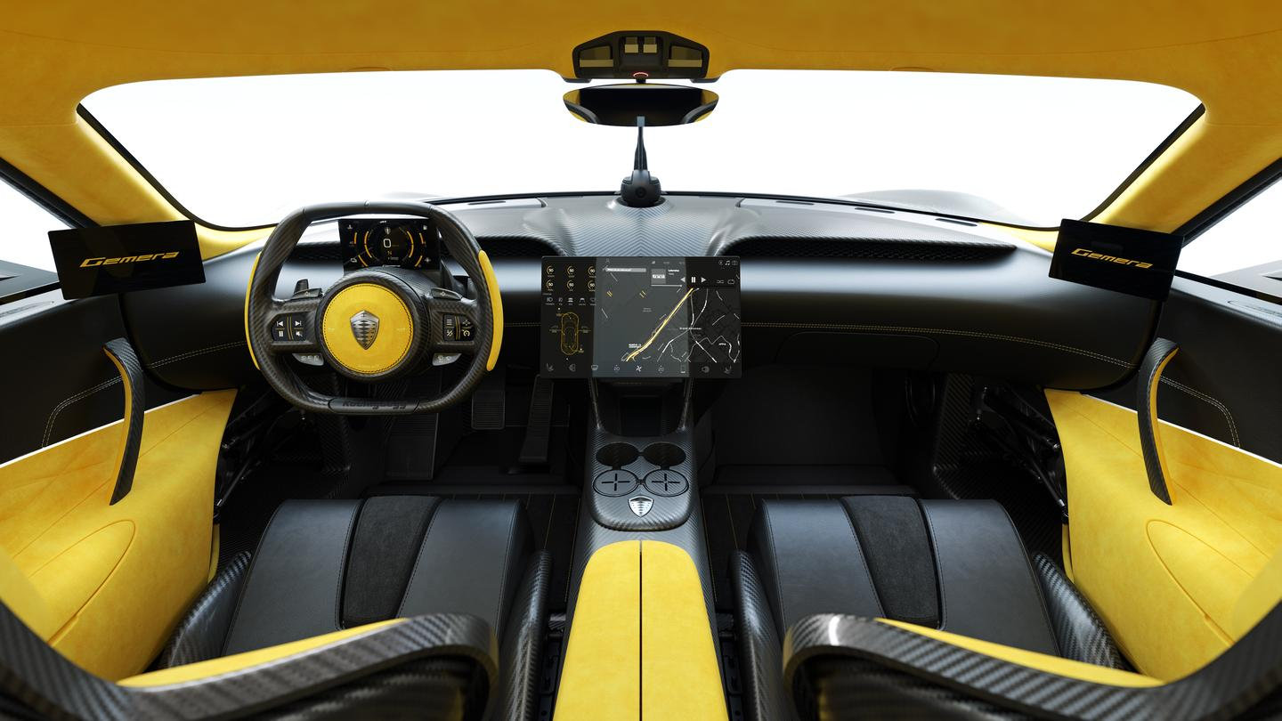The Koenigsegg Gemera cockpit includes a large central infotainment screen, digital instruments and side-view camera displays