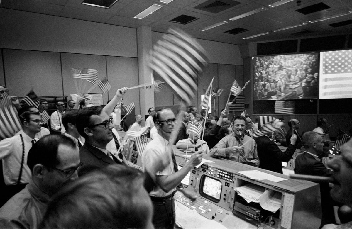 Flight controllers seen celebrating the Apollo 11 mission onJul 24, 1969