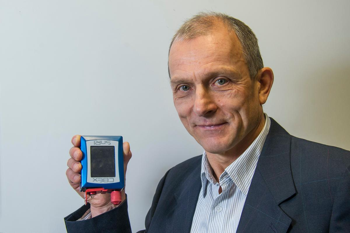 Prof. Igor Lednev with a portable Raman spectrometer – the device that he's creating would likely be similar in form