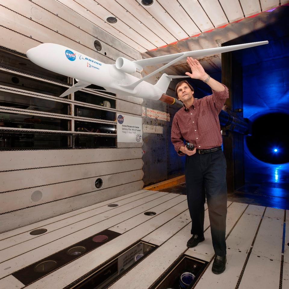 Greg Gatlin, NASA aerospace research engineer, inspects the truss-braced wing during testing in the Unitary Plan Wind Tunnel complex at NASA's Ames Research Center in Silicon Valley