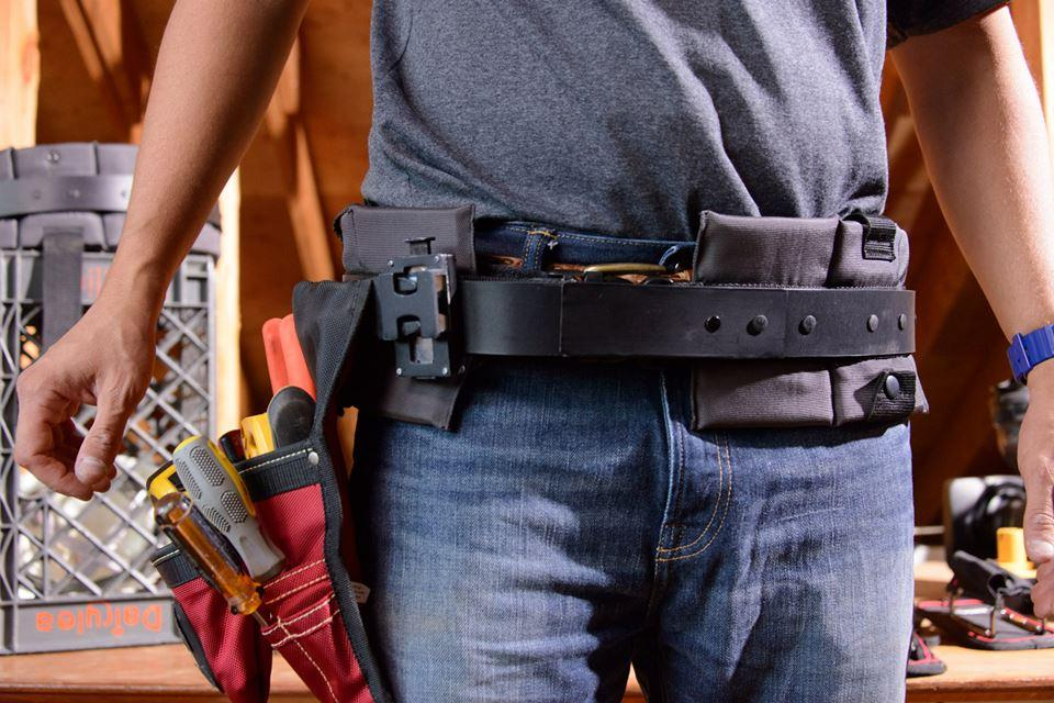 The TrakBelt360 allows pouches and tool holsters to be rotated around it, while the belt itself stays in place