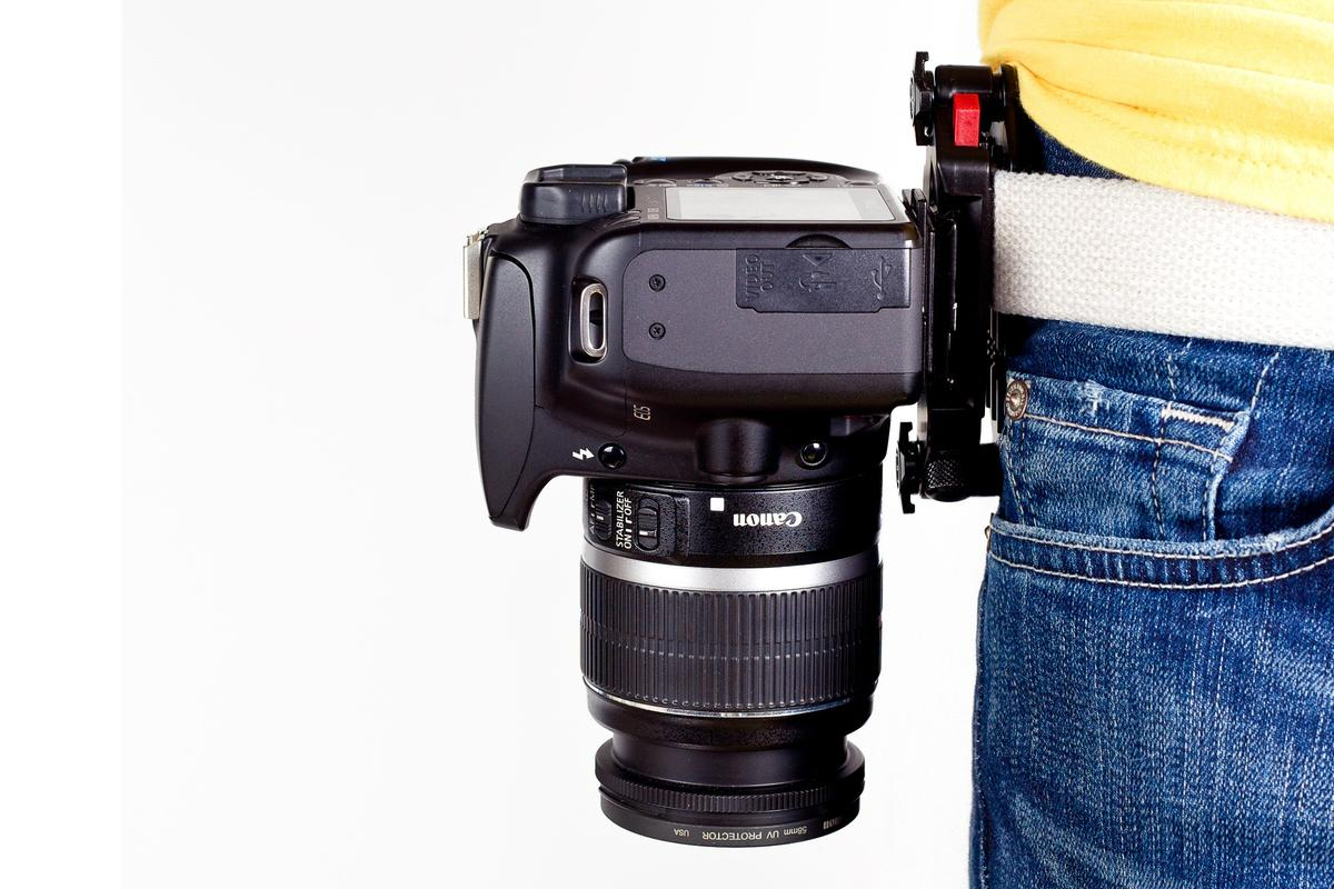 After attaching a plate to the bottom of a camera and then clamping the Capture Camera Clip's main chassis to a belt or bag strap, users can grab and shoot the DSLR as quick as a gunslinger from a cheesy Western