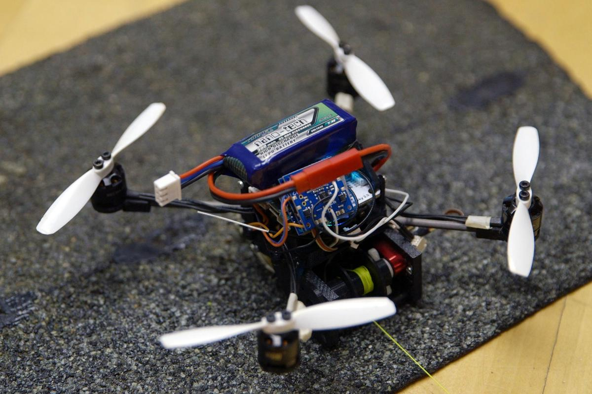 Gecko-inspired adhesives allow the FlyCroTug micro-drone to perch on smooth surfaces, but hook-like microspines are used for rough surfaces