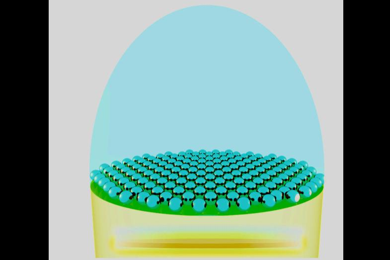 A diagram depicting the nanoparticle layer (blue dots) above the LED chip (yellow)