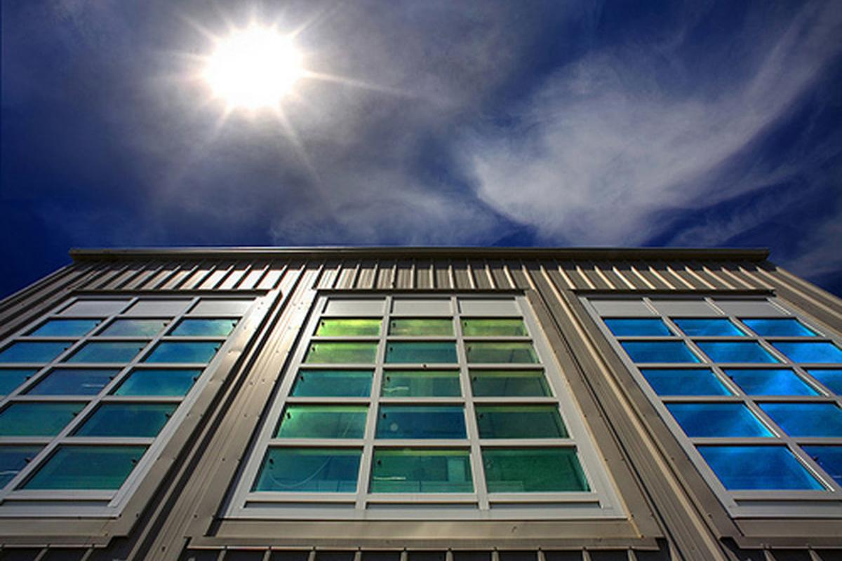 Image of windows treated with a nanocrystal material that can selectively block light and/or heat to improve energy efficiency