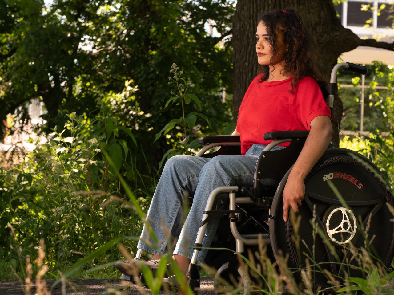 Using the Rowheels Revolution wheelchair is reported to require less force than pushing and makes use of larger muscles