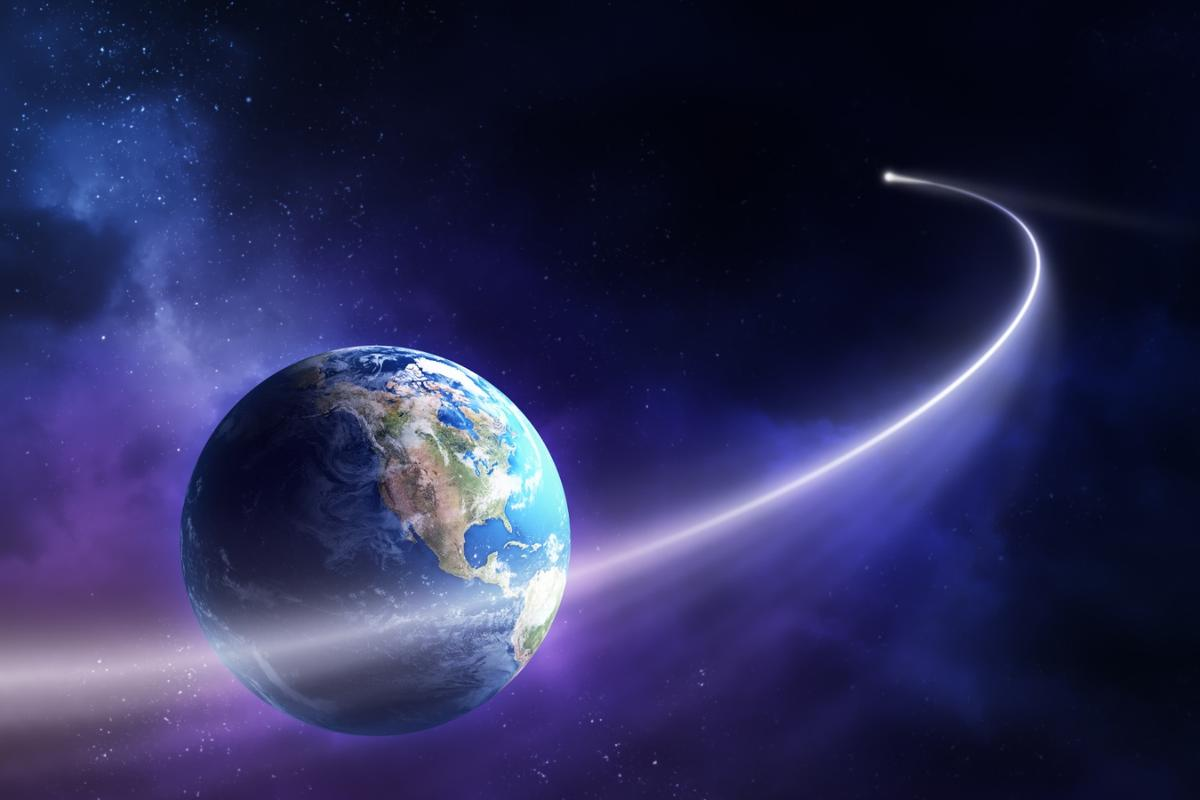 An artist's rendition of an asteroid swinging past Earth