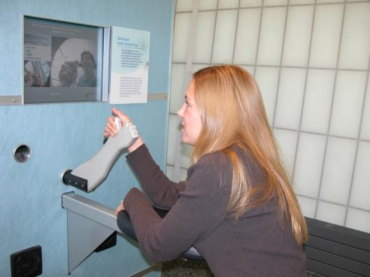 Wendy J. Brez tests out the machine at the New York Hall of Science in Queens, NY.