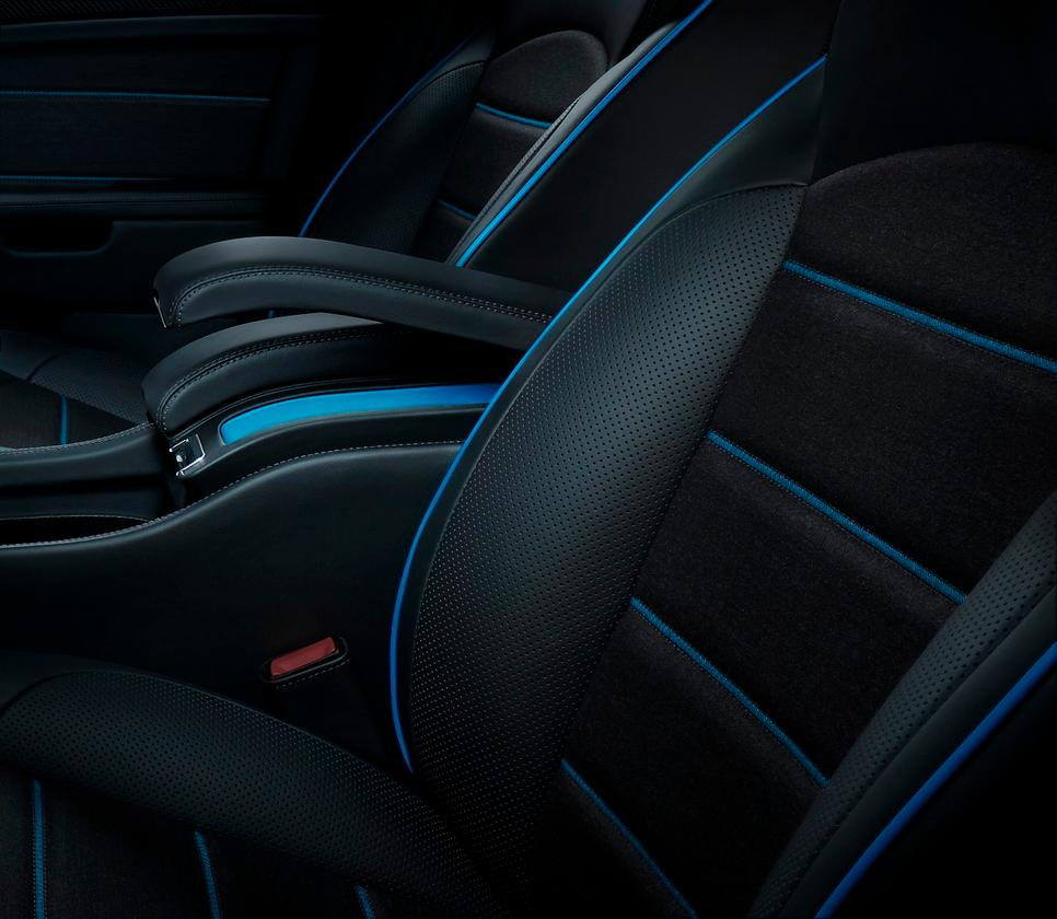The Kingfisher blue piping and stitching provides some pop against the all-black interior