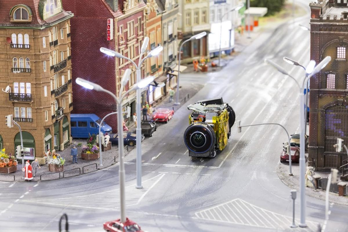 One of the miniature Google Street View camera vehicles takes to the streets at Miniatur Wunderland