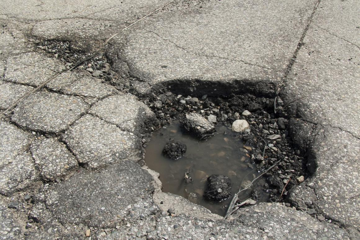A group of students have created a unique material that they say could be sealed in bags with water, then used to temporarily fill potholes (Photo via Shutterstock)