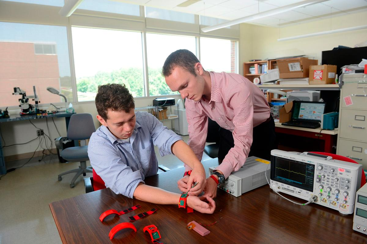Researchers work with prototype HET wristbands