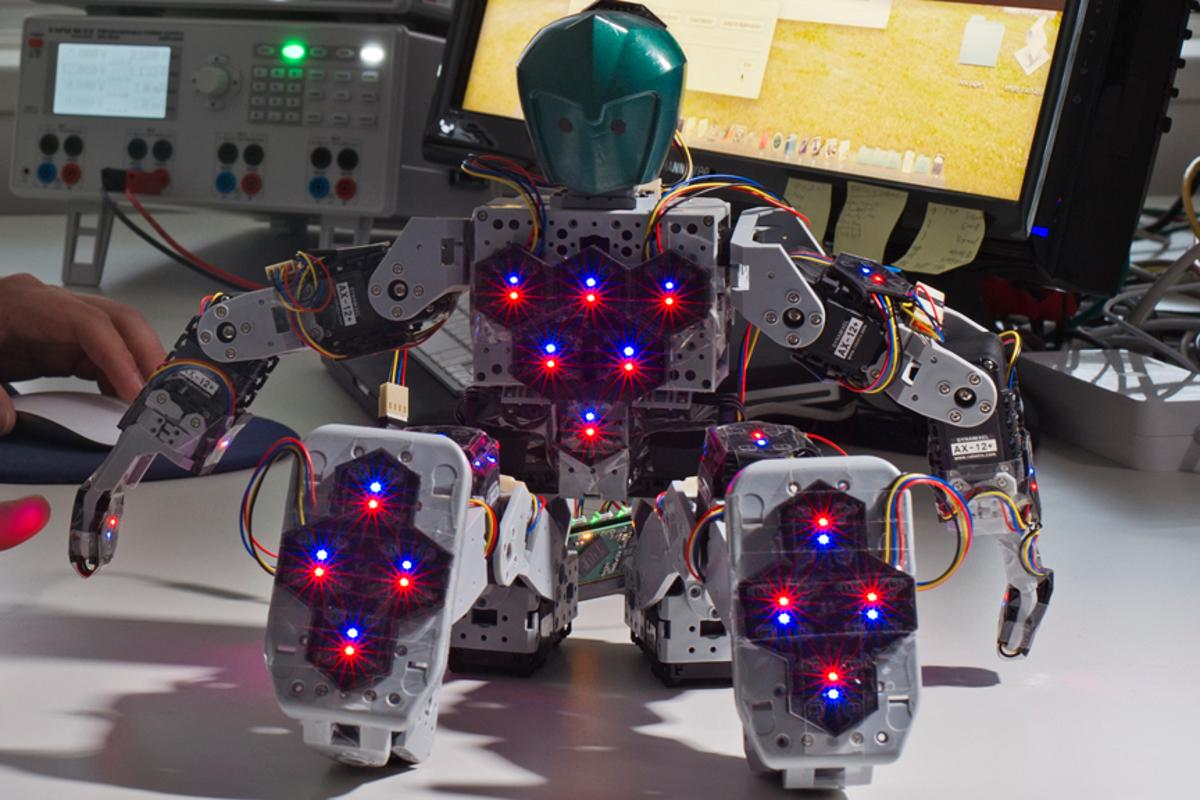 Bioloid Robot with 31 hexagonal sensor modules distributed throughout its body to give it the sense of touch (Image: Andreas Heddergott / TU Munich)
