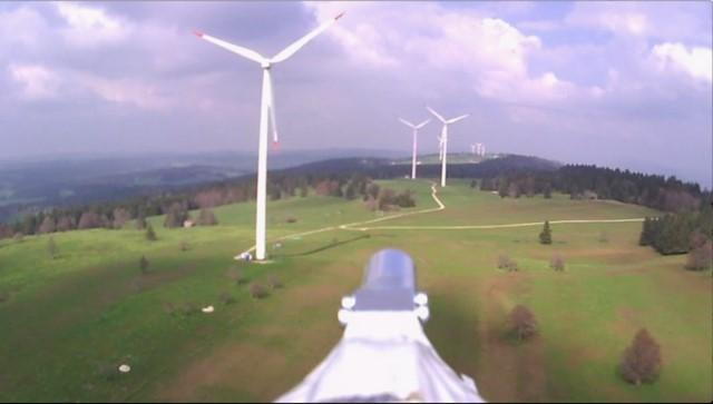 View from the field testing in a wind farm of the Swissteam'snovel instrumented drone fitted with a suite of sensors.
