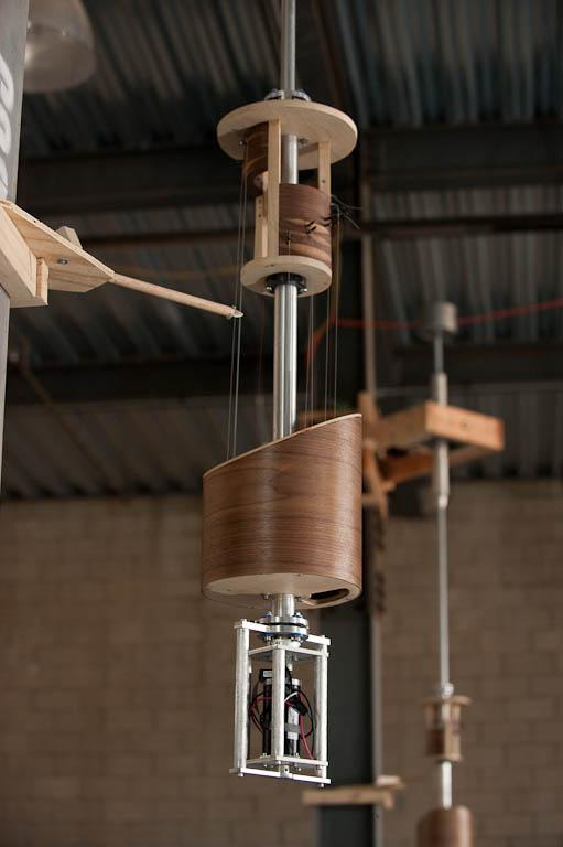 This innovative musical instrument features four robotic pendulums, each housing an eleven string harp (image from Pattern Studio)