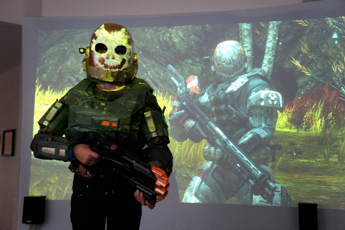 Brandon Sobchyshyn in his one-of-a-kind Emile costume, alongside an image of the actual Halo character