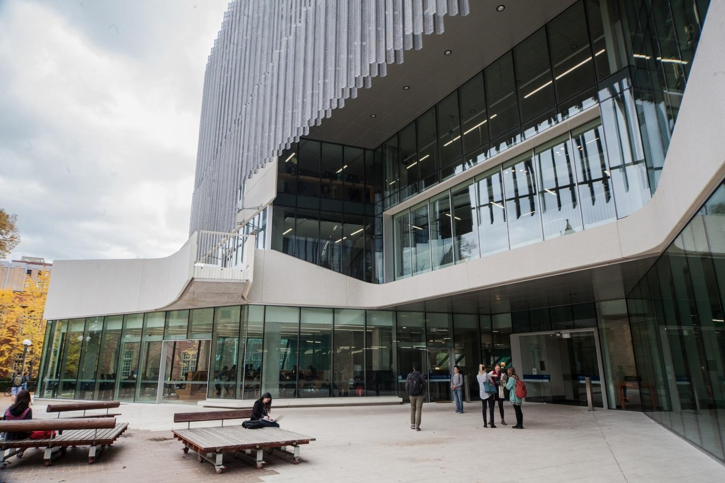 On the ground floor of the building, a thoroughfare handles foot traffic from all across the university