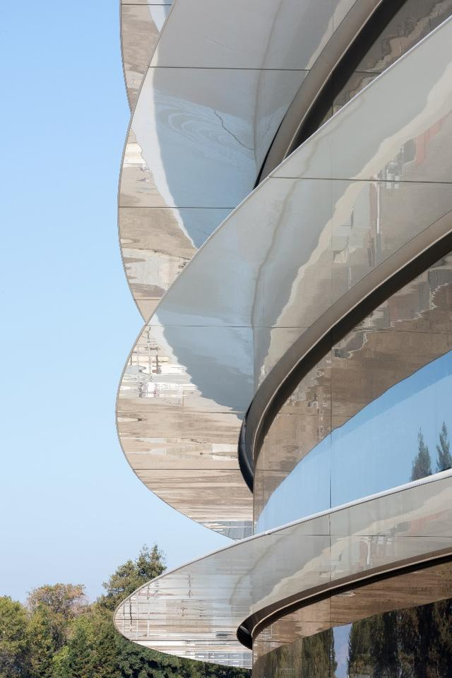 Apple Park is clad in the world's largest panels of curved glass